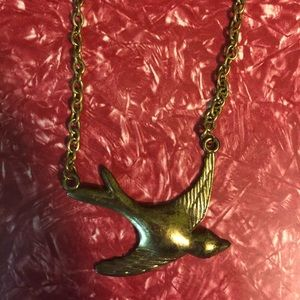 Gold tone bird necklace